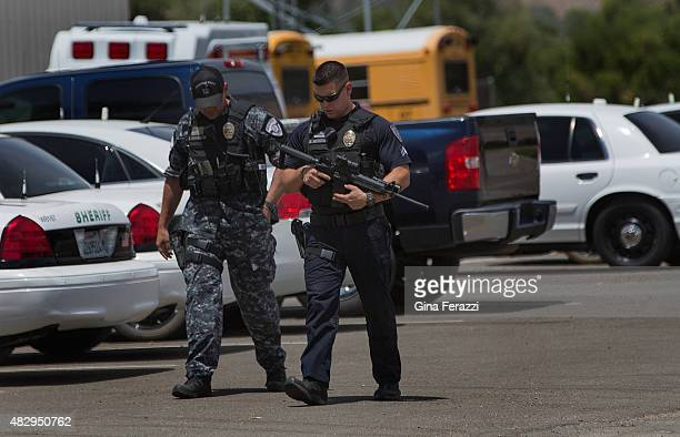 Ridgecrest Police Officers join in the manhunt for a murder suspect who also shot and wounded two Kern County Sheriff deputies near the intersection...