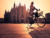 Riding a bicycle in Milan city at sunset.Tilt & Shift. The photo has been taken during iStockalypse 2011 in Milan.