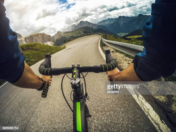 POV riding a road racing bicycle on mountain pass
