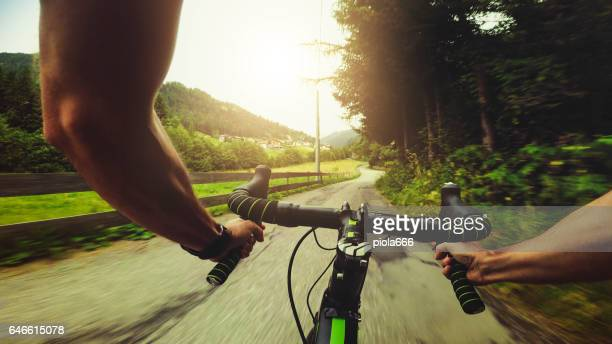 POV riding a road racing bicycle on the mountain