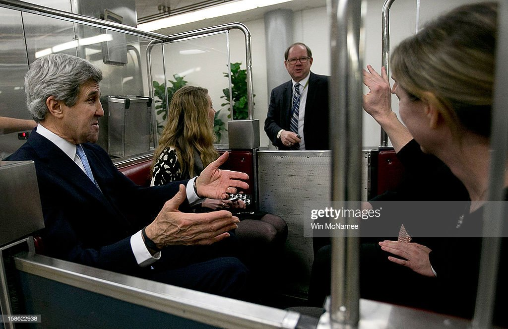 Riding a subway at the U.S. Capitol, Sen. <a gi-track='captionPersonalityLinkClicked' href=/galleries/search?phrase=John+Kerry&family=editorial&specificpeople=154885 ng-click='$event.stopPropagation()'>John Kerry</a> (D-MA) (L) talks with reporters after his nomination by U.S. President Barack Obama as the next Secretary of State December 21, 2012 in Washington, DC. If confirmed, Kerry will replace retiring Secretary of State Hillary Clinton early in 2013.