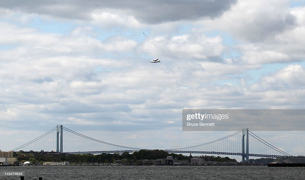 Riding atop a 747 shuttle carrier aircraft, the space shuttle Enterprise flies over the Verazzano Narrows bridge in New York Harbor on April 27, 2012 in New York City. Enterprise, which was flown from Washington, DC, will eventually be put on permanent display at the Intrepid Sea, Air and Space Museum.