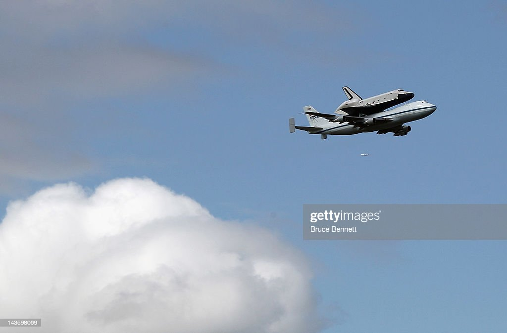 Riding atop a 747 shuttle carrier aircraft, the space shuttle Enterprise flies over New York Harbor on April 27, 2012 in New York City. Enterprise, which was flown from Washington, DC, will eventually be put on permanent display at the Intrepid Sea, Air and Space Museum.