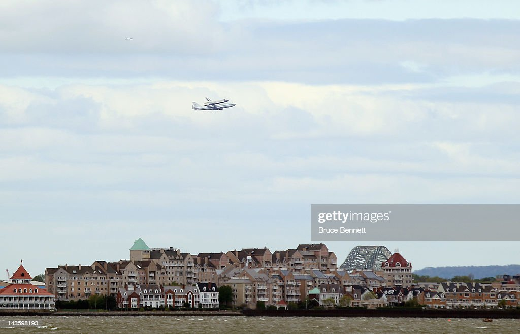 Riding atop a 747 shuttle carrier aircraft, the space shuttle Enterprise flies over Staten Island on April 27, 2012 in New York City. Enterprise, which was flown from Washington, DC, will eventually be put on permanent display at the Intrepid Sea, Air and Space Museum.