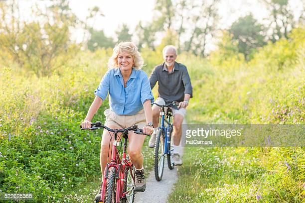 Riding Bikes on a Trail Through a Field