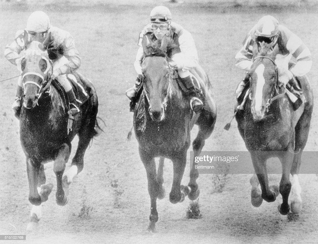 Riding 'Bridle 'N Bit' Diane Crump keeps right up with Mike Sorentino who's on 'Born In A Trunk' an Craig Perret on 'ShirTee' during the seventh race...