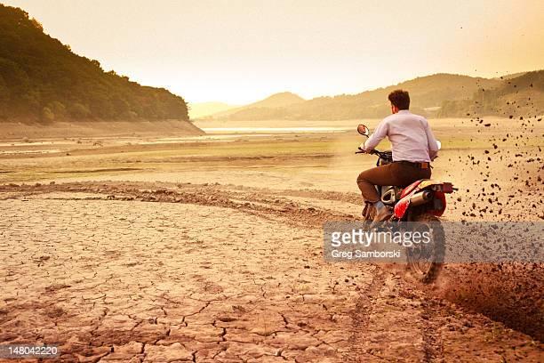 Riding dirt-bike in dirt road