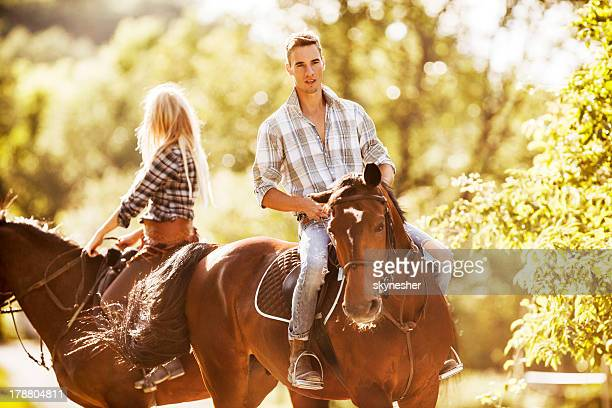 Riding horses.