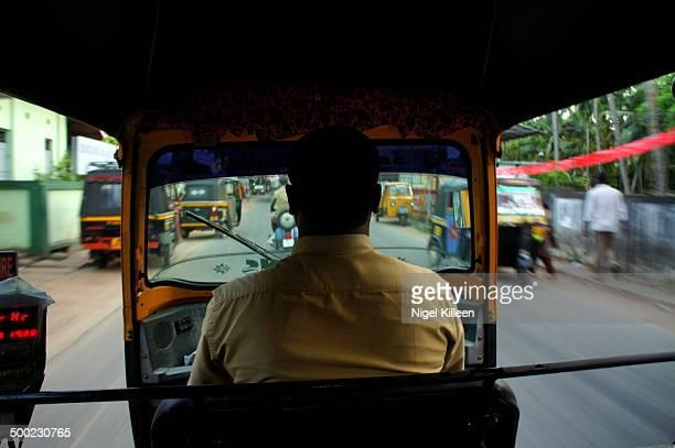 Riding in back of Tuk Tuk in traffic Kochi India