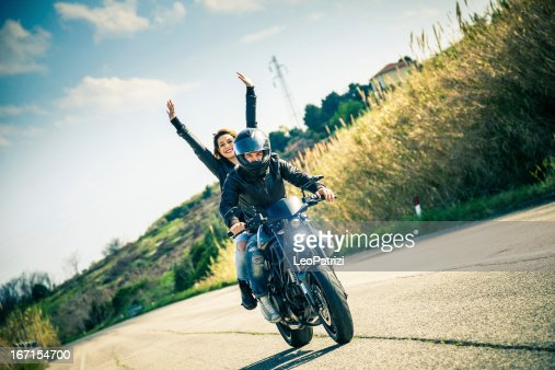 Riding on a fast motorcycle with girlfriend