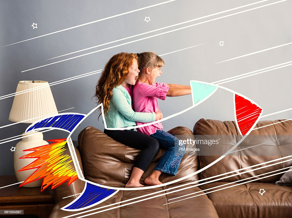 Riding on a sofa rocketship : Stock Photo