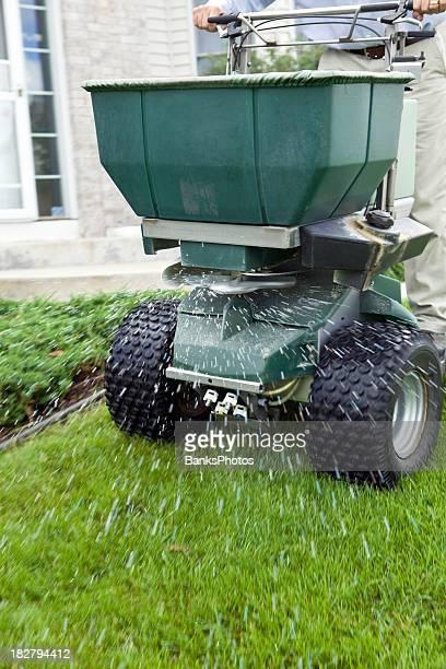Riding Spreader Applying Fertilizer to Lawn