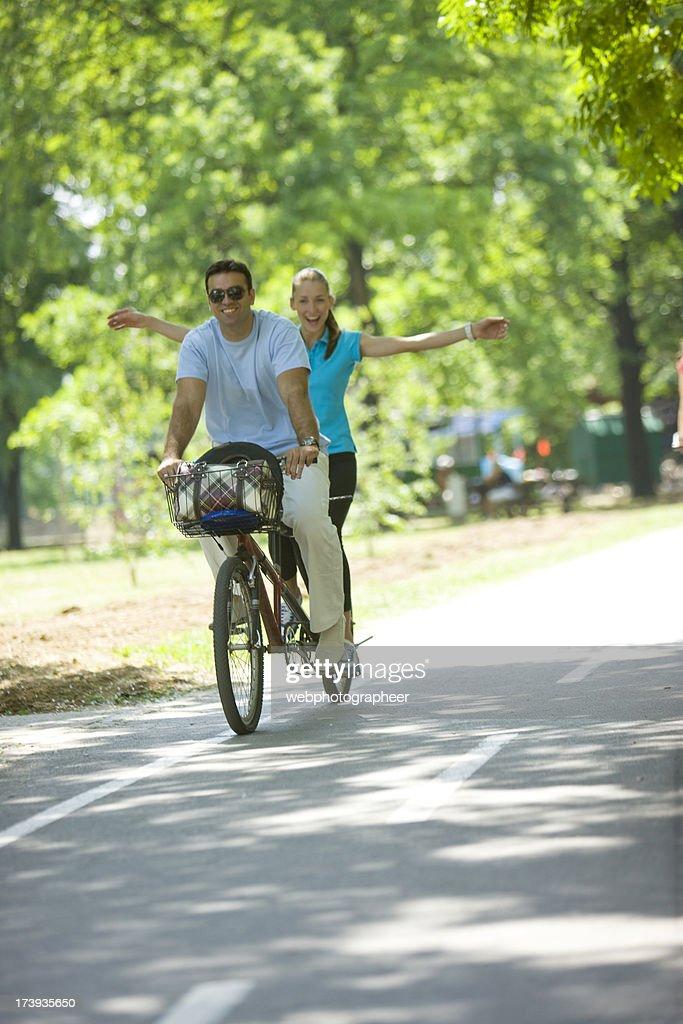 Riding tandem bicycle : Stock Photo