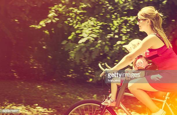 Riding the bicycle with daughter