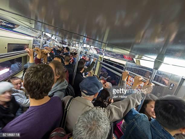 Riding the New York City Subway.