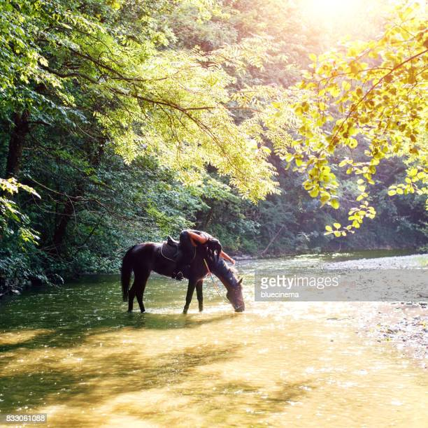 Riding woman in river