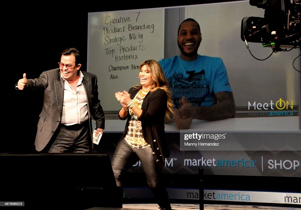 JR Ridinger, Loren Ridinger and Carmelo Anthony at the 2014 Market America World Conference at American Airlines Arena on February 8, 2014 in Miami, Florida.