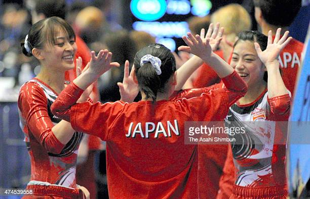 Rie Tanaka Koko Tsurumi and Yuko Shintake high five in the Women's qualification during the day two of the Artistic Gymnastics World Championships...