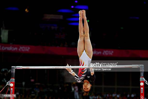 Rie Tanaka of Japan competes on the uneven bars in the Artistic Gymnastics Women's Team final on Day 4 of the London 2012 Olympic Games at North...