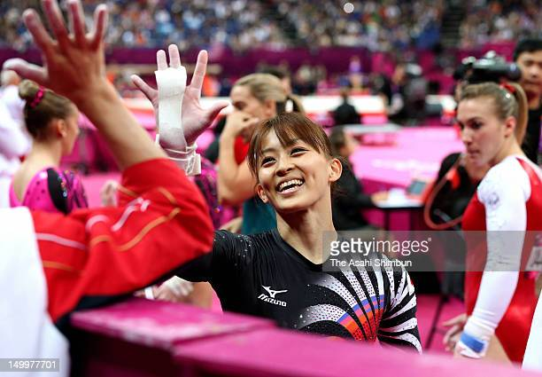 Rie Tanaka of Japan reacts after competing in the uneven bars in the Artistic Gymnastics Women's Team final on Day 6 of the London 2012 Olympic Games...