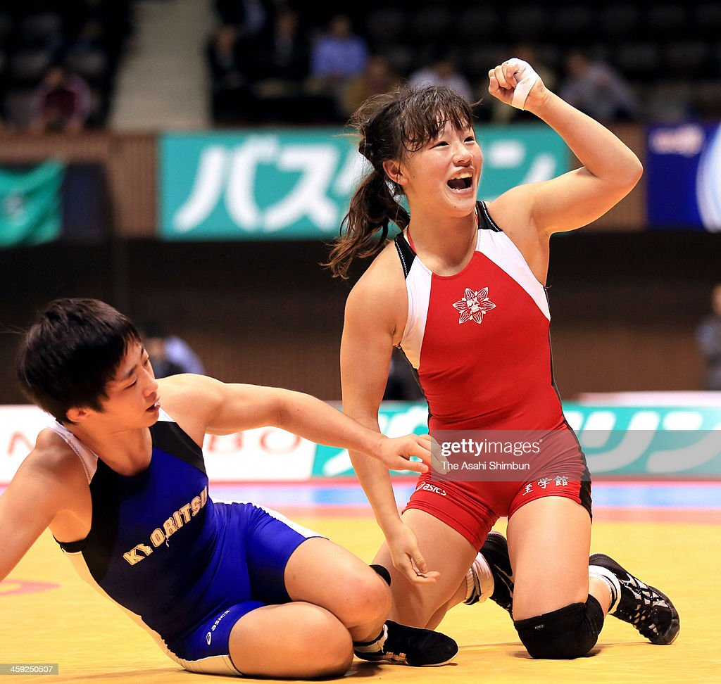 Rie Tosaka (R) celebrates winning against Yuki Irie in the Women's 48kg Final during day two of the All Japan Wrestling Championships at Yoyogi Gymnasium on December 22, 2013 in Tokyo, Japan.