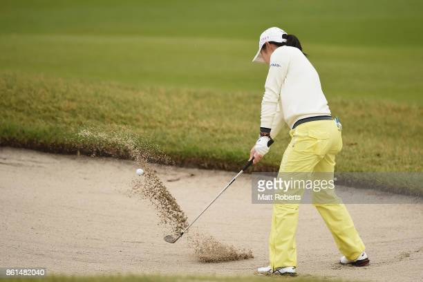 Rie Tsuji of Japan hits out of the 5th green bunker during the final round of the Fujitsu Ladies 2017 at the Tokyu Seven Hundred Club on October 15...