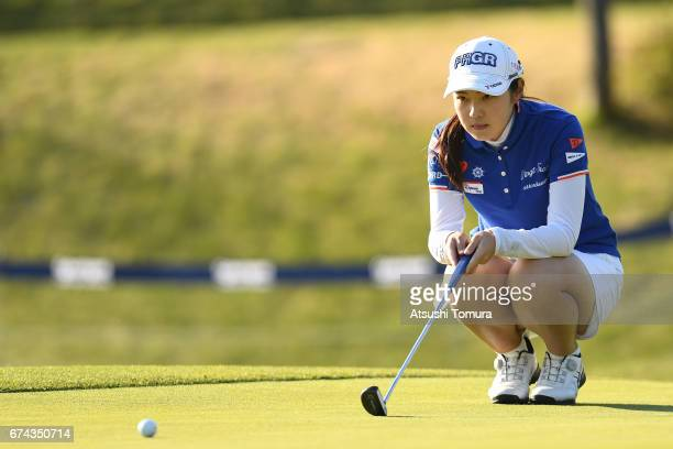 Rie Tsuji of Japan lines up her putt on the 18th green during the first round of the CyberAgent Ladies Golf Tournament at the Grand Fields Country...