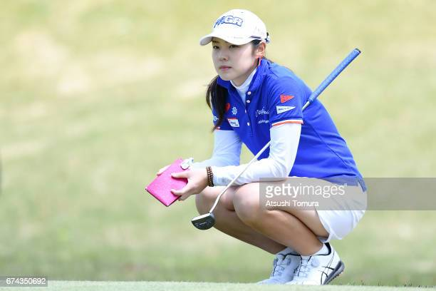 Rie Tsuji of Japan lines up her putt on the 1st hole during the first round of the CyberAgent Ladies Golf Tournament at the Grand Fields Country Club...
