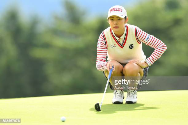 Rie Tsuji of Japan lines up her putt on the 1st hole during the second round of Stanley Ladies Golf Tournament at the Tomei Country Club on October 7...