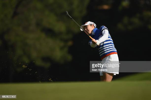 Rie Tsuji of Japan plays her approach shot on the 1st hole during the final round of the HokennoMadoguchi Ladies at the Fukuoka Country Club Wajiro...