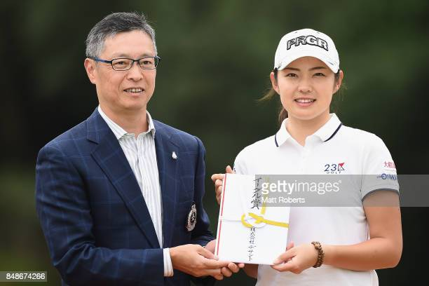Rie Tsuji of Japan poses for a photograph at the presentation ceremony during the final round of the Munsingwear Ladies Tokai Classic 2017 at the...
