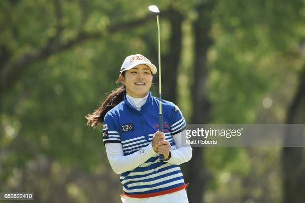 Rie Tsuji of Japan reacts after her putt on the 8th green during the final round of the HokennoMadoguchi Ladies at the Fukuoka Country Club Wajiro...