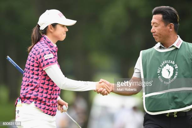 Rie Tsuji of Japan shakes hands with her caddie on the 18th green during the second round of the NEC Karuizawa 72 Golf Tournament 2017 at the...