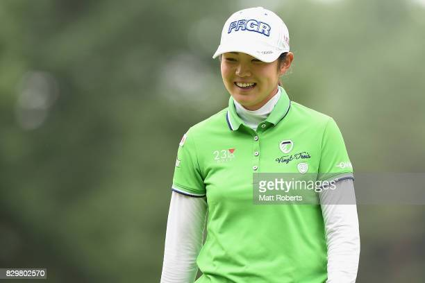 Rie Tsuji of Japan smiles after her putt on the first green during the first round of the NEC Karuizawa 72 Golf Tournament 2017 at the Karuizawa 72...