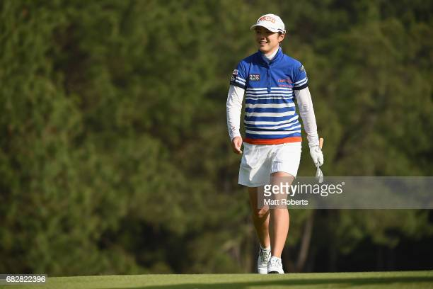 Rie Tsuji of Japan smiles as she walks onto the 1st green during the final round of the HokennoMadoguchi Ladies at the Fukuoka Country Club Wajiro...