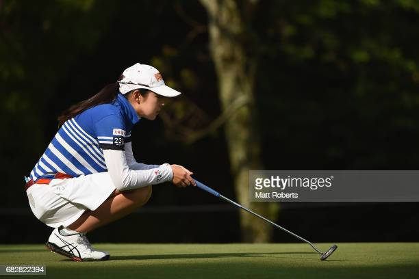 Rie Tsuji of Japan waits to putt the 1st green during the final round of the HokennoMadoguchi Ladies at the Fukuoka Country Club Wajiro Course on May...