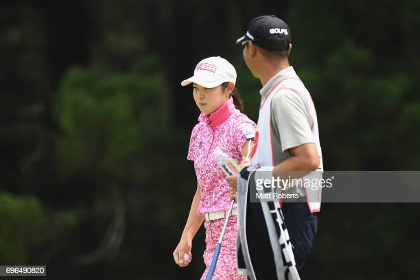Rie Tsuji of Japan walks off the first green during the first round of the Nichirei Ladies at the Sodegaura Country Club Shinsode Course on June 16...