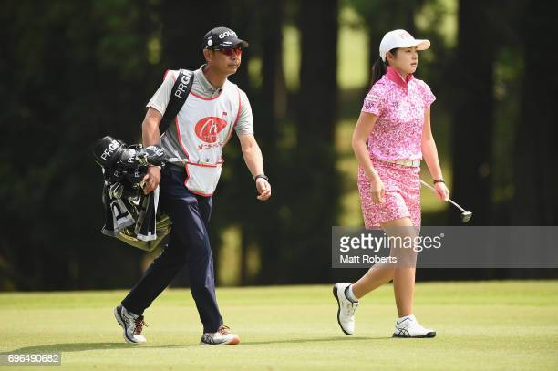Rie Tsuji of Japan walks the first fairway with her caddie during the first round of the Nichirei Ladies at the Sodegaura Country Club Shinsode...