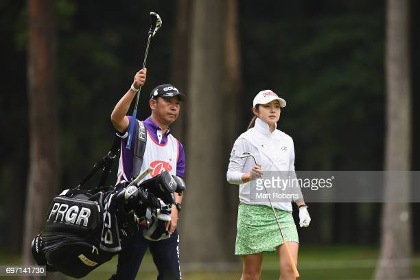 Rie Tsuji of Japan walks with her caddie to the 10th green during the final round of the Nichirei Ladies at the on June 18 2017 in Chiba Japan