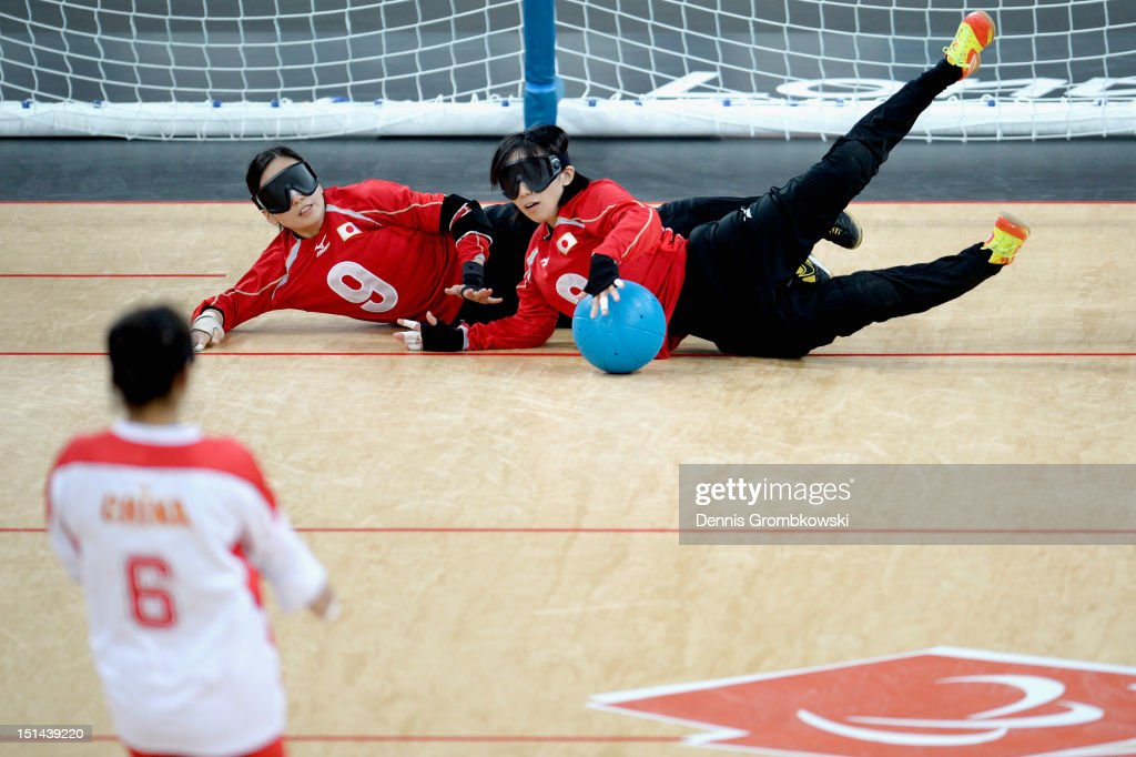 Rie Urata of Japan and Akiko Adachi block the ball during their Women's Team Goalball Gold Medal match against China on day 9 of the London 2012 Paralympic Games at The Copper Box on September 7, 2012 in London, England.