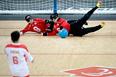 Rie Urata of Japan and Akiko Adachi block the ball during their Women's Team Goalball Gold Medal match against China on day 9 of the London 2012...