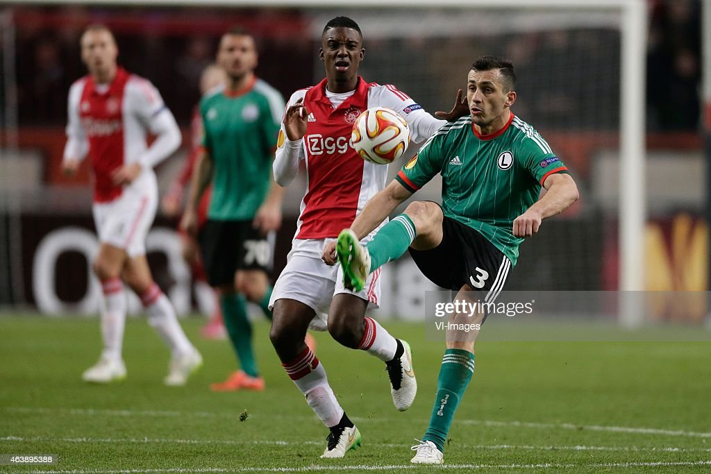 Riechedly Bazoer of Ajax, <a gi-track='captionPersonalityLinkClicked' href=/galleries/search?phrase=Tomasz+Jodlowiec&family=editorial&specificpeople=5700915 ng-click='$event.stopPropagation()'>Tomasz Jodlowiec</a> of Legia Warszawa during the round of 32 UEFA Europa League match between Ajax and Legia Warsaw on February 19, 2015 at the Amsterdam Arena in Amsterdam, The Netherlands.