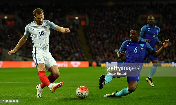 Riechedly Bazoer of the Netherlands slides in to tackle Harry Kane of England during the International Friendly match between England and Netherlands...