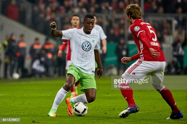 Riechedly Bazoer of VfL Wolfsburg and Mats Hummels of Bayern Muenchen battle for the ball during the DFB Cup RoandOf 16 match between Bayern Muenchen...