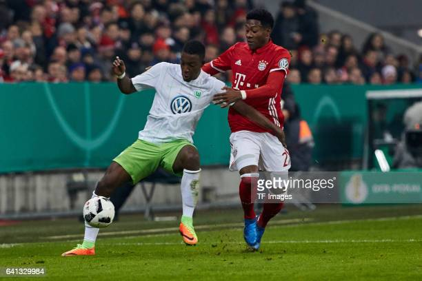 Riechedly Bazoer of VfL Wolfsburg andDavid Alaba of Bayern Muenchen battle for the ball during the DFB Cup RoandOf 16 match between Bayern Muenchen...