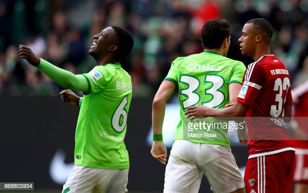Riechedly Bazoer of Wolfsburg celebrate the opening goal during the Bundesliga match between VfL Wolfsburg and FC Ingolstadt 04 at Volkswagen Arena...