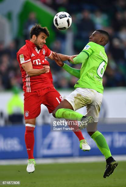 Riechedly Bazoer of Wolfsburg is challenged by Juan Bernat of Muenchen during the Bundesliga match between VfL Wolfsburg and Bayern Muenchen at...