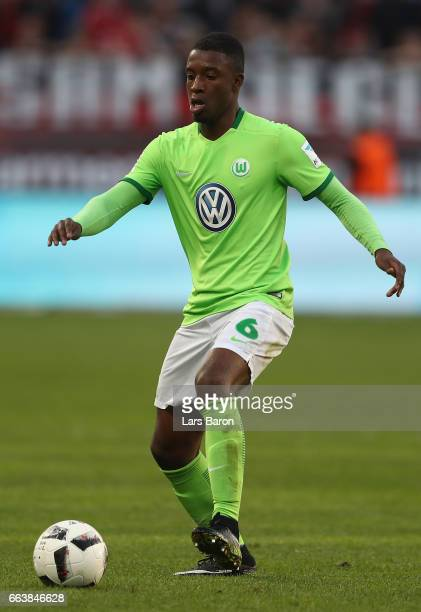 Riechedly Bazoer of Wolfsburg runs with the ball during the Bundesliga match between Bayer 04 Leverkusen and VfL Wolfsburg at BayArena on April 2...