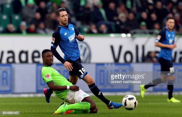 Riechedly Bazoer of Wolfsburg vies with Mark Uth of Hoffenheim during the German First division Bundesliga football match between VfL Wolfsburg v TSG...
