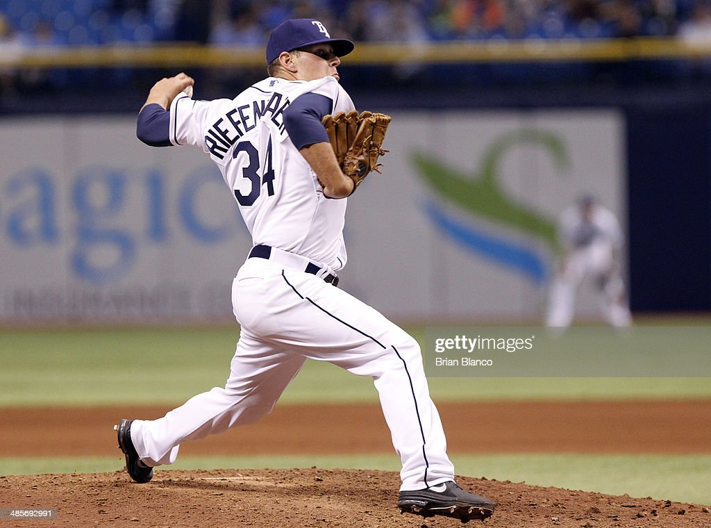 C.J. Riefenhauser of the Tampa Bay Rays pitches during the eighth inning of a game against the New York Yankees on April 19, 2014 at Tropicana Field in St. Petersburg, Florida.